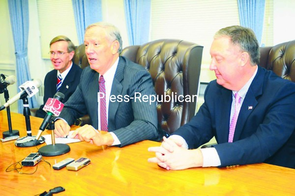 Former New York Gov. George Pataki (center), now chairman of Revere America, joined Plattsburgh Mayor Donald Kasprzak (right) and former congressional candidate Doug Hoffman for a news conference Thursday at Plattsburgh City Hall.<br><br>(Staff Photo/Kelli Catana)