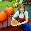 Cheryl Wood, pie maker, poses with one of her pumpkin creations outside of Banker Orchards in West Plattsburgh.<br><br>(P-R Photo/Andrew Wyatt)