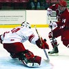 Goaltender Ryan Williams denies Nick Jensen (14) in Plattsburgh State's Annual Red/White men's hockey scrimmage Saturday night at Stafford Arena.<br><br>(P-R Photo/Gabe Dickens)