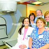 The staff at the FitzPatrick Cancer Center have been working there since it opened March 24, 1990. (Left to right)Shari Williams, dosimetrist; Linda Ellsworth, RN; John Griffin, MD; Sandy Caron, Clerk 3. (Front) Kathryn Bracero, supervisor of oncology services. Sandy Wallett, the radiation therapist, is not shown.<br><br>(Staff Photo/Kelli Catana)