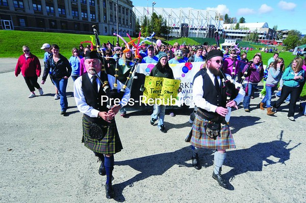More than 500 people showed up in Lake Placid Sunday for the Out of the Darkness march for the American Foundation for Suicide Prevention. The march, in its second year, was held to raise money for the prevention of suicide. Sunday's activities brought in about $16,000 for the cause.<br><br>(P-R Photo/Jack LaDuke)