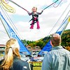 Erin Lewis, 4, of Newark Valley bounces high above her parents' heads at the 19th-annual Whiteface Mountain Oktoberfest Saturday. There were lots of games for the children and good German food for everyone. The Oktoberfest festivities continue today.  <br><br>(P-R Photo/Jack LaDuke)