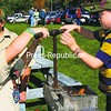 Hundreds of visitors strolled the grounds of Penfield Museum in Ironville to enjoy the recent Apple Folk Fest. Activities included music, displays of antique equipment and toys, chili, apple desserts, cider pressing, wagon rides and a craft fair. Here, Alex Russell (left) and Tim Russell of Crown Point Scout Troop 70 help press apples for cider.<br><br>(Staff Photo/Alvin Reiner)