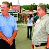 """Essex County sheriff candidates Richard Cutting (right) and Michael """"Ike"""" Tyler stand together on the midway at this year's Essex County Fair in Westport.<br><br>(Staff Photo/Alvin Reiner)"""