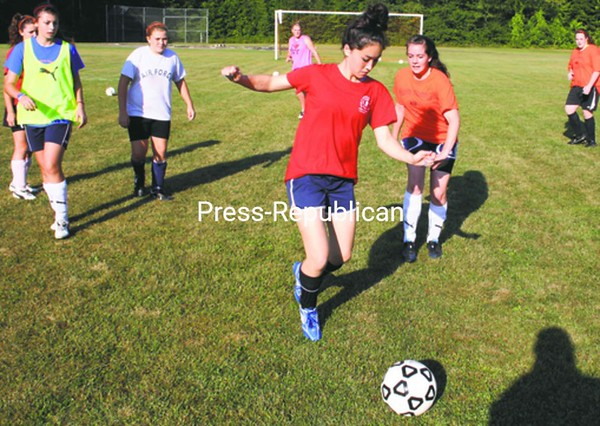 The Keene Central girls go through preseason drills Thursday in preparation for next week's opener in Mountain & Valley Athletic Conference soccer.<br><br>()