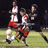 Plattsburgh High School's David Carpenter and Saranac's Patrick Robare (20) contest the ball during the Hornets' 3-0 victory in CVAC boys' soccer Friday.<br><br>(P-R Photo/Gabe Dickens)