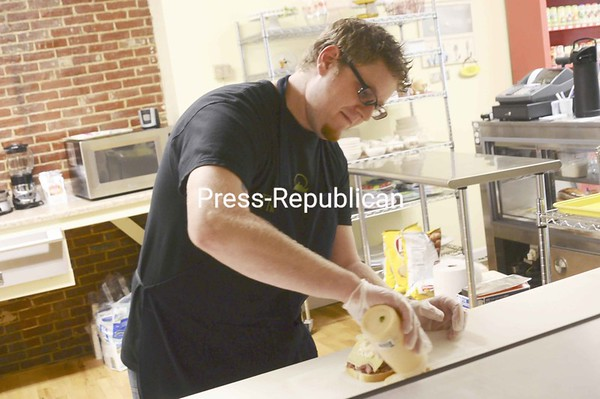 """Co-owner and chef Brent Davis creates a """"Der Kaiser"""" sandwich with rare seasoned roast beef, gold label swiss, coleslaw and Russian dressing at My Cup of Tea cafe and tea room at 50 Margaret St. in Plattsburgh. The tea room offers teas, baked goods, fresh salads, sandwiches and soups from 8 a.m. to 3 p.m. Monday through Friday. <br><br>(P-R Photo/Andrew Wyatt)"""