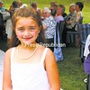 A budding model, MacKenzie Peters shows off a flower girl outfit from the Fashion Corner of Port Henry.<br><br>(Staff Photo/Alvin Reiner)