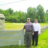 Clinton Community College President John Jablonski (right) and local business owner and philanthropist George Moore stand at the Clinton Community College entrance. Moore donated $25,000 to help rebuild the historic boundary wall.<br><br>(P-R Photo)