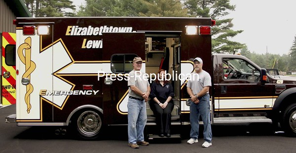 Elizabethtown-Lewis Emergency Squad members Charlie Martin (left), Susie Saska and Larry Bashaw pose by the new ambulance, which shows a convenient side entry. <br><br>(Staff Photo/Alvin Reiner)