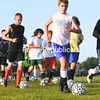 The Elizabethtown-Lewis boys' soccer team goes through a six-time-around-the-field dribbling warm-up Tuesday in preparation for the Mountain & Valley Athletic Conference season. The Lions finished 5-2-2 in conference play last year and 12-3-2, overall. <br><br>(Staff Photo/Alvin Reiner)