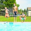 Tommy Dubay (left), Maxim Rock (center) and Jack Dubay jump into the Dubay family pool in Peru, trying to beat record-high temperatures this week. Things are expected to cool down considerably this weekend, with rain and temperatures in the low 70s.<br><br>(P-R Photo/Joanne Kennedy)