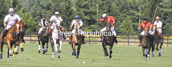 Action was fast and furious in a polo match between the Adirondack (in red) and Sugarbush (in white) polo clubs Sunday in Westport. Sugarbush galloped to a hard-played victory. The event was held to raise money for the Ronald McDonald House Charities. All matches have been to assist charities, with the next event in Westport scheduled for Saturday, Sept. 18, at 1 p.m.<br /><br />(Staff photo/Alvin Reiner)