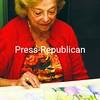 Artist Ellen Heyman with work-in-progress in her Plattsburgh studio.<br><br>(Staff Photo/Robin Caudell)