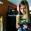 Peyton Falb texts a friend at her home in West Plattsburgh Saturday morning.<br><br>(P-R Photo/Gabe Dickens)