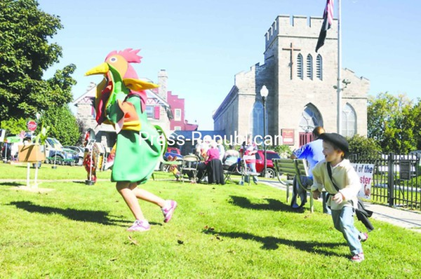 Gideon Sayward of Peru chases down Jenny Cibula, also of Peru, dressed as a rooster. She was asked to be a mascot for the Plucky Rooster contest.<br><br>(P-R Photo/Andrew Wyatt)