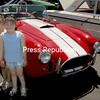 Future customers? Katlyn and Cheyanne Westover, ages 5 and 4, stand by a Ford Cobra that was on display at the 100th-anniversary celebration.<br><br>(Staff Photo/Alvin Reiner)