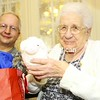 Lorena Weldon opens gifts with her nephew, Warren Bressette, as she celebrates her 100th birthday recently at Meadowbrook Healthcare, where she lives.<br><br>(Staff Photo/Kelli Catana)