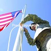 United States Staff Sgt. Cory Perrea of Mooers Forks raises the American flag to half-staff on a new flagpole.<br><br>(P-R Photo/Gabe Dickens)