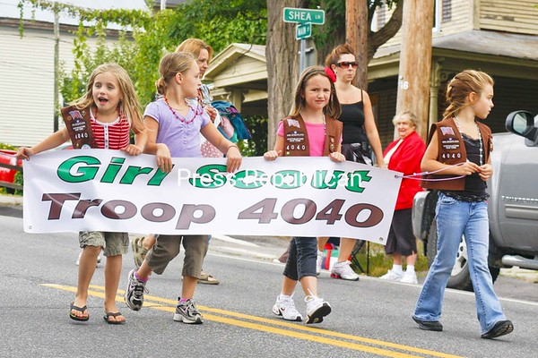 Girl Scout Troop 4040 marches in the Port Henry Labor Day Parade Sunday.<br><br>(Staff Photo/Lohr McKinstry)