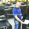 Voting machine technician Gary DeCelle demonstrates the use of one of Clinton County's new voting machines. Two new machines will completely replace lever voting machines. The ballot-marking device includes features that help voters with visual impairment. The second device is referred to as a scanner voting machine. Both include paper ballots and computer memory cards that will prevent miscounts. DeCelle said that all the machines are simple to use.<br><br>(P-R Photo/Andrew Wyatt)