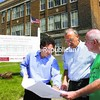 Developer Eli Schwartzberg (left) discusses his plans for converting the old Willsboro Central School building into an assisted-living center with Willsboro Code Officer Jim Kinley (center) and Town Council member Charlie Lustig.<br><br>(Staff Photo/Alvin Reiner)