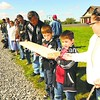 Hundreds of young and old members of the Akwesasne reservation turned out Friday to see a famous wampum belt delivered by canoe. The treasured tribal artifact was brought to the shore of the St. Lawrence River in Hogansburg, where a line of residents passed the belt from person to person until it arrived at the Akwesasne Museum. Ernest Benedict (below), 92, of the Akwesasne Reservation in Hogansburg got his first look Friday at a wampum belt that could be 250 years old. The belt is believed to represent a peace treaty, of sorts, between the Mohawks of the St. Lawrence River and the British or French. The belt had been in the State Museum in Albany and has now been returned to the Akwesasne Museum, where it will be placed in a vault.<br><br>(P-R Photo/Jack LaDuke)