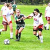 Chazy's Caitlyn LaPier drives through Willsboro's Emily Sayward (left) and Serene Holland. The Eagles scored twice in the second half for a 2-0 win.<br><br>(Staff Photo/Alvin Reiner)