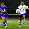Peru's Stephanie Omlin (10) sends a pass forward to a teammate with AuSable Valley's Liz Rennie (9) in pursuit during a Champlain Valley Athletic Conference girls' soccer game Saturday. AuSable Valley won, 2-1. Bonus photos will be available at pressrepublicanphotos.com by midday Monday.<br><br>(P-R Photo/Gabe Dickens)