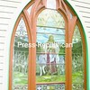 This is one of the two stained-glass windows targeted for restoration at St. Philip Neri Catholic Church in Westport. Donations are being sought to help fund the work.<br><br>(Staff Photo/Lohr McKinstry)