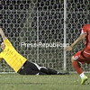Beekmantown's Zack Towle (19) strikes a shot just out of the reach of Plattsburgh High keeper Chris Roenbeck in the shootout for the Frankie Garrow Memorial Tournament Saturday night in Chazy. Beekmantown won in the shootout 3-1 after both teams played to a scoreless draw in regulation. <br><br>(P-R Photo/Gabe Dickens)