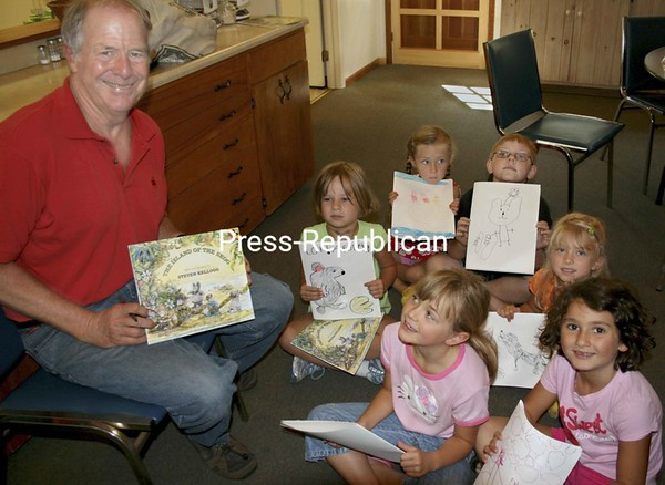 """Show and tell… Steven Kellogg and budding illustrators show off their endings of """"Island of the Skog"""" at the end of the workshop. <br><br>(Staff Photo/Alvin Reiner)"""