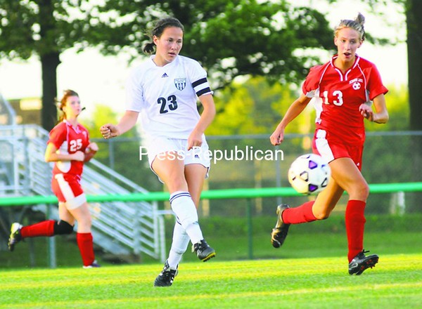 Chazy co-captain Astrid Kempainen (23) puts her right foot into this shot during the MVAC girls' soccer opener Tuesday in Chazy. Schroon Lake halfback is Rebecca Armstrong (13). Kempainen finished with two goals, three assists in 10-0 victory. Bonus photos of this game will be available at pressrepublicanphotos.com by midday. <br><br>(Staff Photo/Kelli Catana)