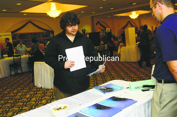 Jordan Maille, 26, of Plattsburgh looks over information on the APG-Neuros table at the Plattsburgh-North Country Chamber of Commerce Job Fair. He is employed, but wanted to check out what's available.<br><br>(Staff Photo/Kelli Catana)