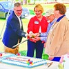 Cakes celebrating the 100th anniversary of the Crown Point State Historic Site were cut with an 18th century military sword Saturday. From left are Site Manager Thomas Hughes, speaker Dougla Pyrke, Friends of Crown Point President John Freilich and Town Historian Joan Hunsdon.<br><br>(Staff Photo/Lohr McKinstry)
