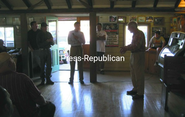 Standing from left: State Assembly candidate Dave Kimmel, Howard Aubin, U.S. congressional candidate Doug Hoffman, LeRoy Douglas and Sandy Lewis. Lewis questions Hoffman about his plans if elected for the 23rd congressional district. <br><br>(P-R Photo/Bob Bennett)