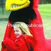 "Jennifer Burdo, 6, of Plattsburgh watches Plattsburgh State Cardinals baseball with the team's trademark mascot ""Burghy."" <br><br>(P-R Photo/Andrew Wyatt)"