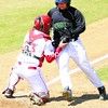 Plattsburgh State catcher Brandon Cross (23) tags out Oswego's Matt Miller (9) at the plate during the first game of Friday's SUNYAC tripleheader. The Cardinals won all three games.<br><br>(P-R Photo/Andrew Wyatt)