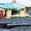 The store building at Marina at Lighthouse Point was battered with waves Saturday, creating structural damage to buildings.<br><br>(P-R Photo/Gabe Dickens)