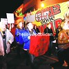 Friday night's Take Back the Night event ended with a march through downtown Plattsburgh. Above, marchers pass the Girls Gone Wild bus that was in town for an event at Therapy Night Club and Sports Lounge.<br><br>(Staff Photo/Kelli Catana)