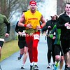 Alex Baker (left to right) of Weedsport, N.Y., Pete Rogers, dressed as former WWF icon Hulk Hogan, from Saranac Lake, and Kevin Rowland of Plattsburgh pass the two mile mark of the Plattsburgh Half Marathon on the Terry Gordon Memorial Bike Path at the U.S. Oval. They would go on to finish 32nd, 120th and 59th overall.<br><br>(P-R Photo/Gabe Dickens)
