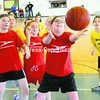 Alicia Goodrow of Mooers Champlain Telephone reaches for a loose ball during the Plattsburgh Youth Tournament Saturday. Teammates Elaina Favreau (left) and Katera Poupore (middle), along with Mooers Beeline's Ashley Monette, look on. Lashway's Lady Bulls and Ellenburg also participated in the tournament.<br><br>(P-R Photo/Andrew Wyatt)