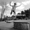 A warm spring sun beats down on Nate Capone of Saranac Lake as he soars over a jump at the local skateboard park behind the Village Police Department. Youths who use the makeshift facility say that they hope for a permanent one someday. <br><br>(P-R Photo/Jack LaDuke)