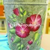 """""""Hibiscus Sap Bucket"""" is one of the featured art pieces on display for """"Brushstrokes & Blossoms,"""" a silent auction through May 4 that benefits the library's Young Adult Room.  <br><br>(P-R Photo/Andrew Wyatt)"""