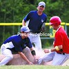 Lyon Mountain Miners shortstop Luke Weaver puts the tag on Fourth Ward Cardinals runner Matt Duquette, who tried to steal second base during the sixth inning of Sunday's CVBL playoff finals. Looking on is Miners second baseman Jamie Juntunen. The Cardinals took a 1-0 lead in the series with a 6-4 victory.<br><br>(P-R Photo/Gabe Dickens)