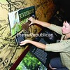 Adirondack History Center Curator Jenifer Kuba decides where to position Rivermede Farm information in relation to the Ausable River drainage map in the Worked/Wild exhibit.<br><br>(Staff Photo/Alvin Reiner)