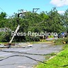 Emergency personnel work to remove a large tree that fell across Route 3 in Cadyville, blocking traffic for 24 hours.<br><br>(P-R Photo/Rob Fountain)
