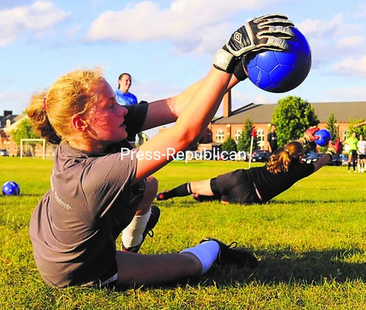 Kelly Cantwell (foreground) of Plattsburgh High School does a goalkeeping drill Thursday during camp at the U.S. Oval. The Plattsburgh State men's soccer team is hosting the camp this week to help prepare boys and girls for the upcoming high school soccer season.<br><br>(P-R Photo/Rob Fountain)