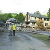 A view of utter devastation in Keene from the piles of rubble left by Gulf Brook, which raged with 11 inches of rain from Irene's tempest on Sunday.<br><br>(Staff Photo/Kim Smith Dedam)