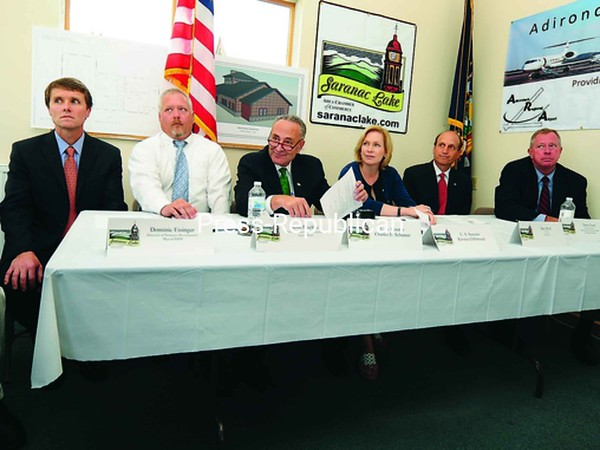 A roundtable discussion at Adirondack Regional Airport brought bio-tech business leaders together with Sens. Charles Schumer and Kirsten Gillibrand on Friday. Included at the table are (from left) Dominic Eisinger, development director for Myriad RBM; Scott Paschke, director of business development for Active Motif; Senator Schumer: Senator Gillibrand; Mass. State Senator Dan Wolf, who is CEO of Cape Air; and Terry Gach, vice president of Institutional Advancement at Trudeau Institute.<br><br>(P-R Photo/Jack LaDuke)